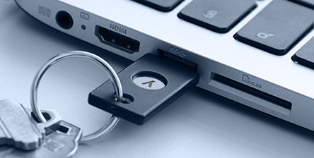 A YubiKey is an authentication device that enables public-key encryption and one-time passwords.