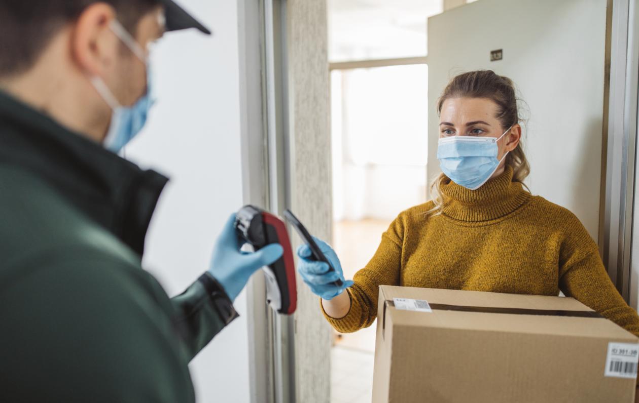 Women wearing mask receiving a package